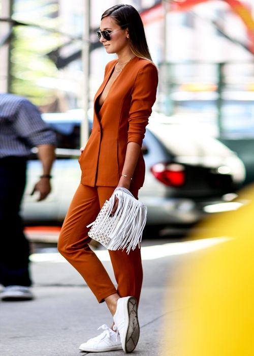 a rust-colored pantsuit, white sneakers for a colorful look and a hint on the fall
