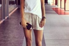 03 a white Celine t-shirt, neutral shorts, black strappy heels and a tiny clutch