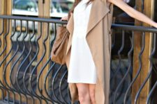 03 a white mini dress, a beige duster vest, nude heels and a brown leather bag for work