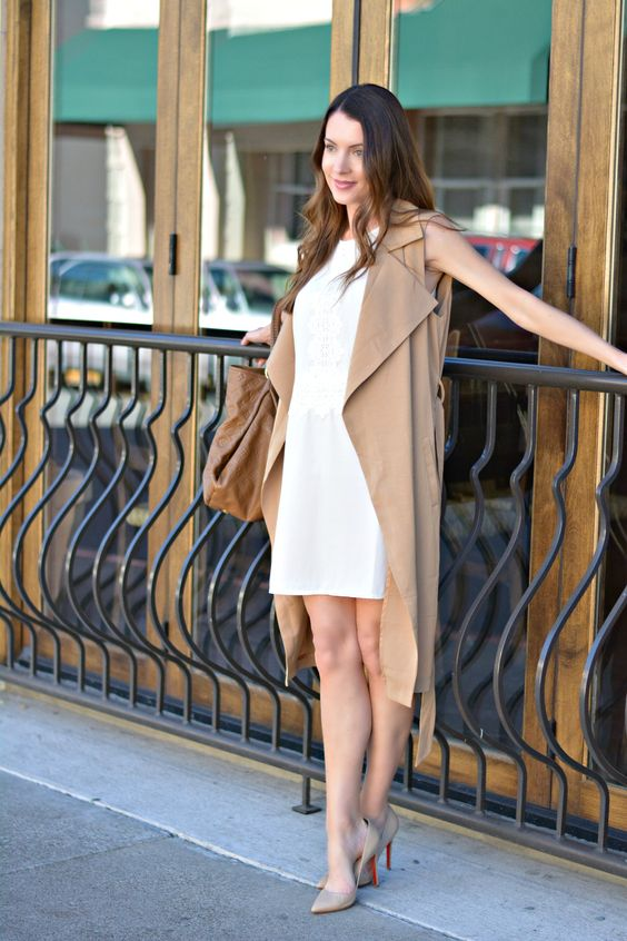 a white mini dress, a beige duster vest, nude heels and a brown leather bag for work