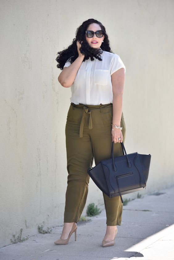 olive green pants, a white shirt with pockets, tan shoes and a black bag