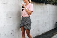 04 a pink logo t-shirt, a gingham black and white ruffled asymmetrical skirt, white sneakers