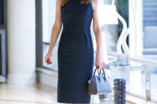 04 a sheath navy dress without sleeves and with side piping to highlight the waist
