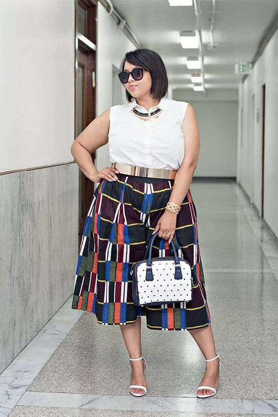 a white sleeveless shirt, colorful printed culottes, white heels and a polka dot bag for a creative work look