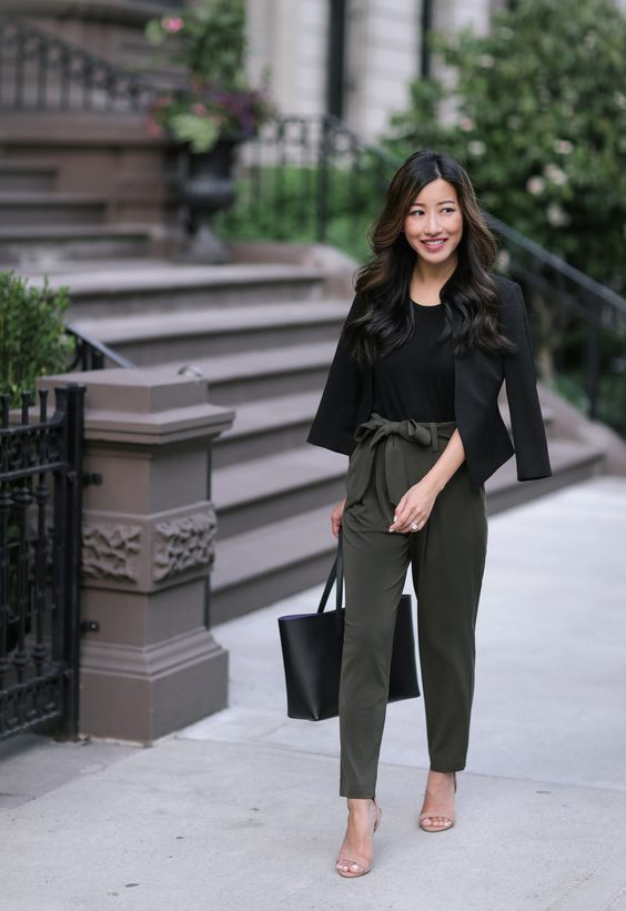 green high waisted pants, a black top, a black cropped blazer, blush shoes and a black bag