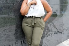 04 olive green pants, a white top with black detailing, leopard print shoes for a chic look