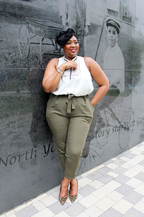 olive green pants, a white top with black detailing, leopard print shoes for a chic look
