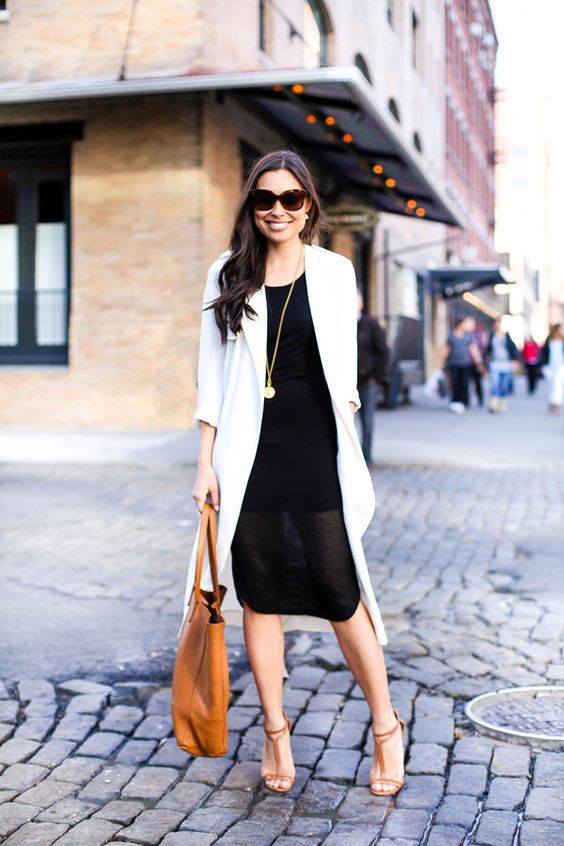 a black knee dress with an illusion skirt, a white silk trench, camel heels and a camel shopper