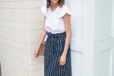 05 a casual summer work look with a striped skirt, a white blouse with ruffled sleeves, nude strappy heels and a bag