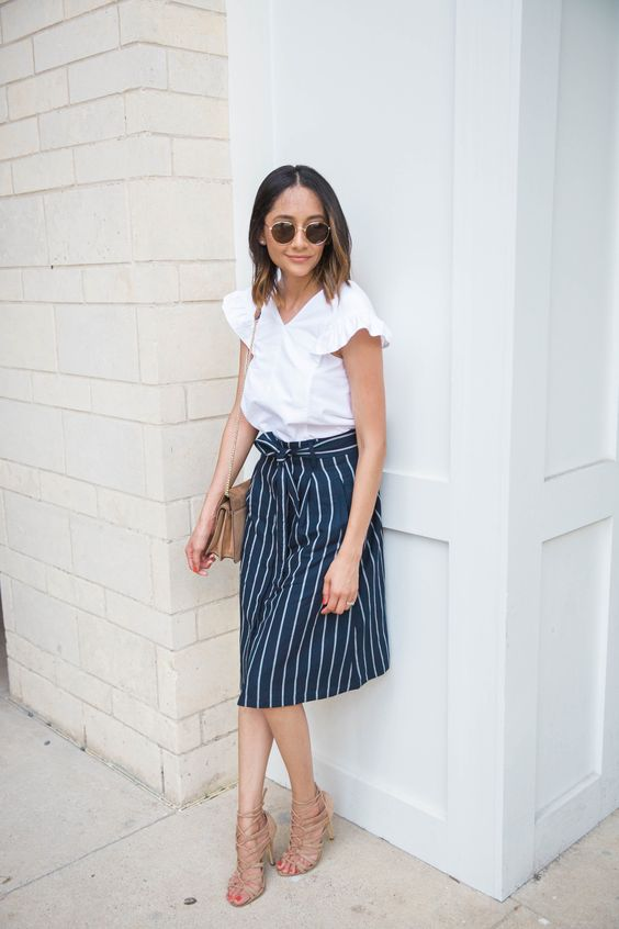 a casual summer work look with a striped skirt, a white blouse with ruffled sleeves, nude strappy heels and a bag