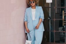 05 a powder blue suit, a white tee, white sneakers and a silver bag