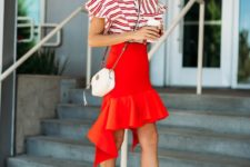 05 a striped red and white shirt, a red asymmetrical skirt, nude shoes and a white bag