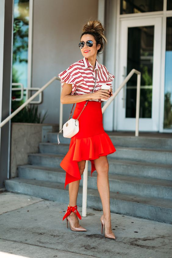 a striped red and white shirt, a red asymmetrical skirt, nude shoes and a white bag