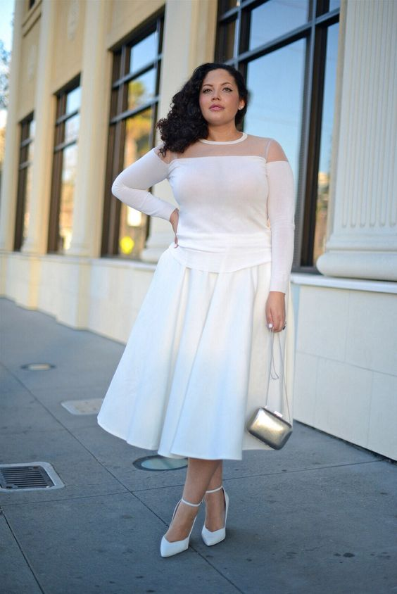 a white A line midi skirt, a white illusion neckline top, wihte heels and a silver bag for a party