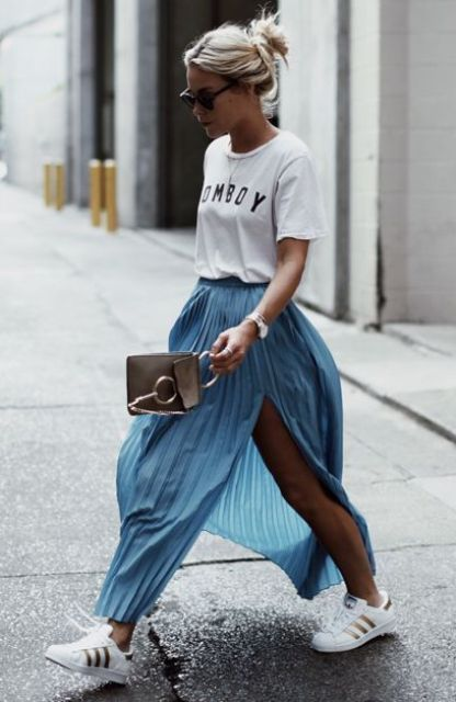 a white printed tee, a blue pleated maxi, white sneakers and a little brown bag