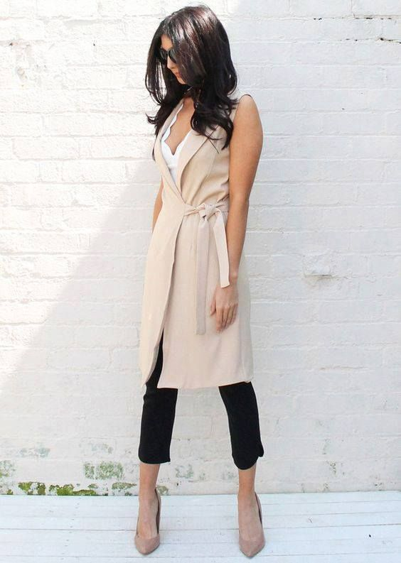 a white top, black cropped pants, a neutral duster vest and nude heels for work