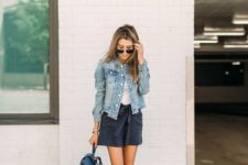 05 a white top, navy denim shorts, a blue denim jacket, a navy backpack and neutral moccasins