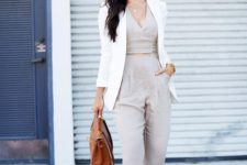05 an off-white jumpsuit, a creamy blazer, tan shoes and a tan bag for a chic touch