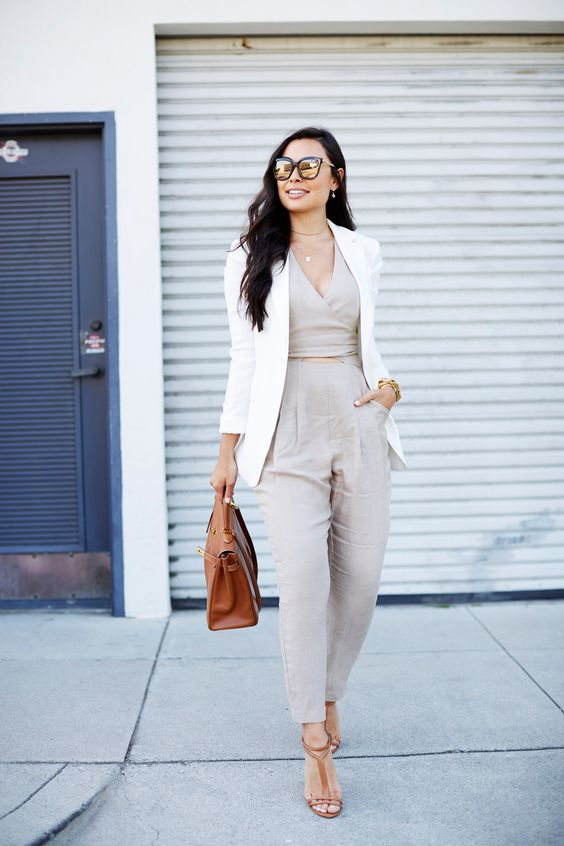 an off-white jumpsuit, a creamy blazer, tan shoes and a tan bag for a chic touch