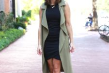 06 a black bodycon dress with an asymmetrical skirt, an olive green duster vest and metallic shoes