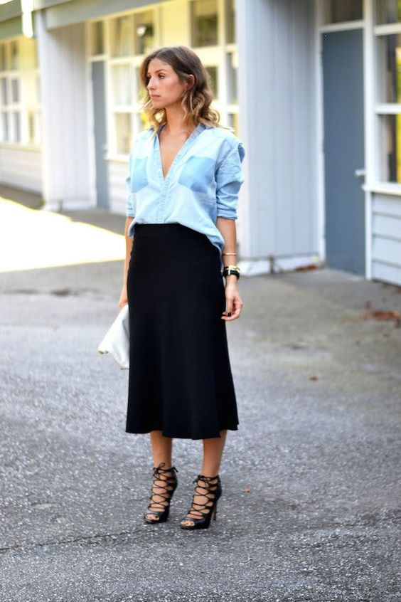 a black midi, a chambray blue shirt, strappy black heels