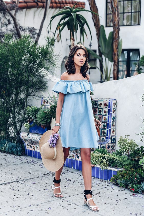 a blue off the shoulder dress, black and white sandals and a hat for a tropical look