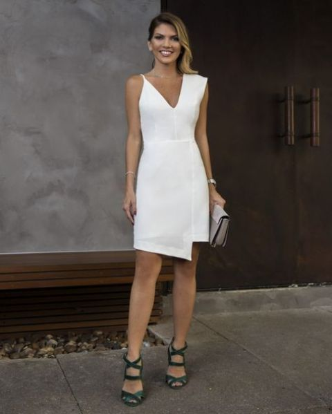 a cool white asymmetrical dress and green strappy shoes for a sexy feel