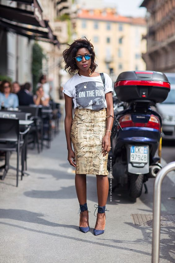 a printed pencil skirt, a printed tee, navy ankle strap shoes and loose hair