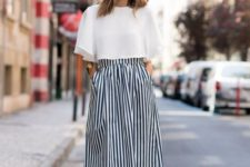 06 a striped navy and white midi skirt, a white crop top, blush tie mules for a trendy touch