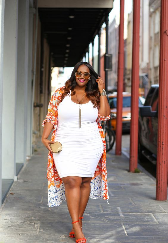 a white bodycon knee dress, a bright floral kimono, orange heels and a small clutch