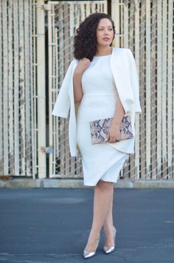 a white knee dress, a white jacket, silver shoes and a snake print clutch for work