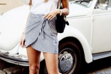 06 a white tee, a gingham mini asymmetrical skirt, black slippers and a bag