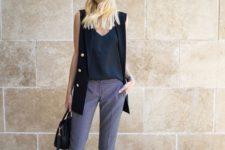 06 printed purple pants, a black top, a black duster vest and nude shoes plus a bag