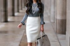 07 a creamy pencil skirt, a grey top with long ruffled sleeves, leopard heels, a grey bag and layered necklaces