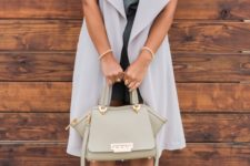 07 a green romper, an off-white duster vest, nude booties and a green bag for the fall