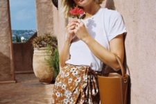 07 a mustard floral midi wrap skirt, a white tee and a trendy brown leather bucket bag