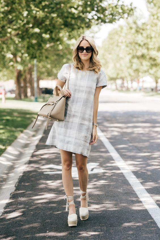 a neutral plaid dress, platform lace up shoes and a neutral bag