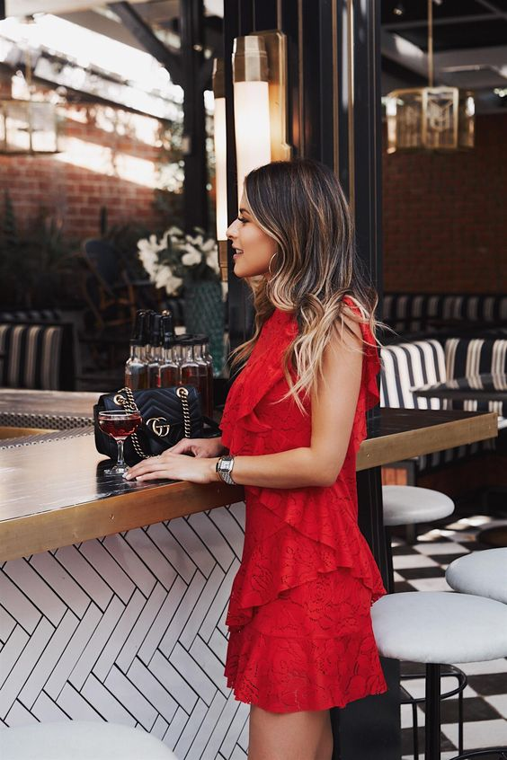 a red sleeveless ruffled mini dress will  work both for a date and for a night out