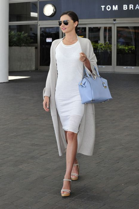 a white bodycon knee dress, a grey long cardigan, neutral shoes and a blue bag for the office
