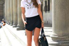 07 a white logo t-shirt, a black asymmetrical mini skirt, red flats and a large bag