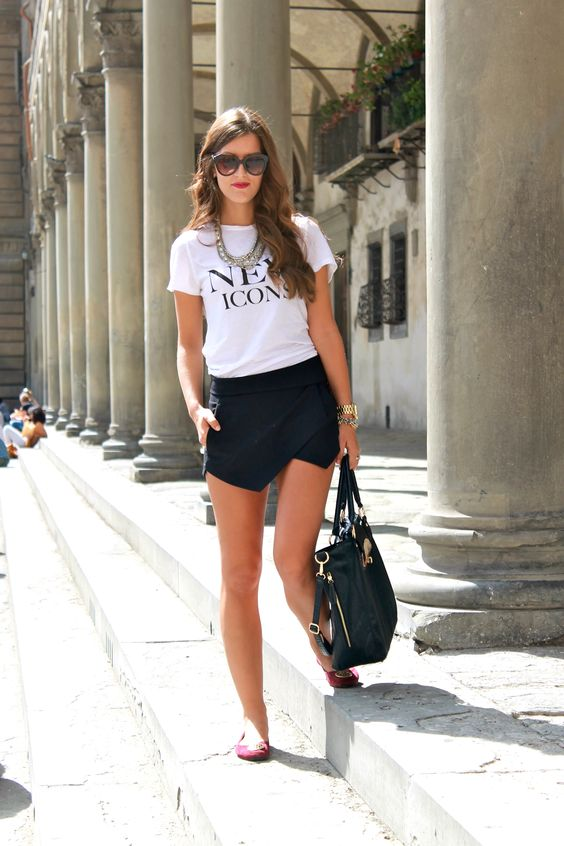 a white logo t-shirt, a black asymmetrical mini skirt, red flats and a large bag