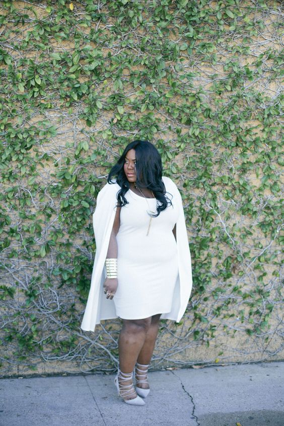 a white sheath dress, a white cape and grey lace up heels for a special occasion