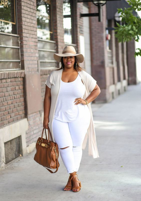 a white top and ripped jeans, a neutral duster, a hat, camel strappy sandals and a bag