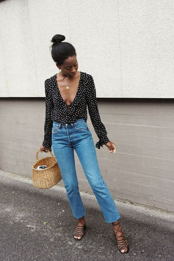 blue cropped jeans, a polka dot black and white ruffled blouse, lace up shoes and a basket