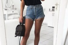 07 blue denim shorts, a black logo tee, white sneakers and a little black backpack