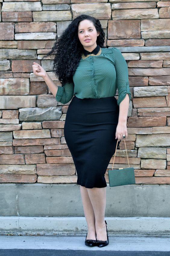 a black pencil skirt, a forest green printed shirt, black shoes and a small clutch