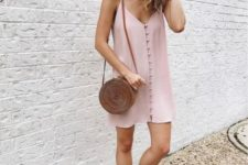 08 a blush slip short dress with a row of buttons, tan strappy sandals and a tan wicker bag