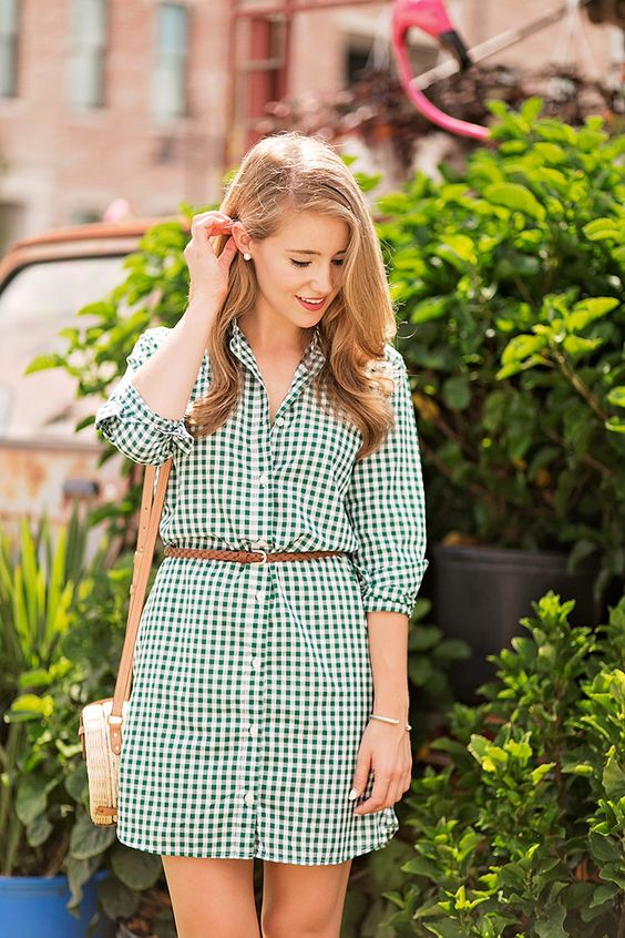 a green and white plaid shirtdress with a belt, a wicker bag for a chic look