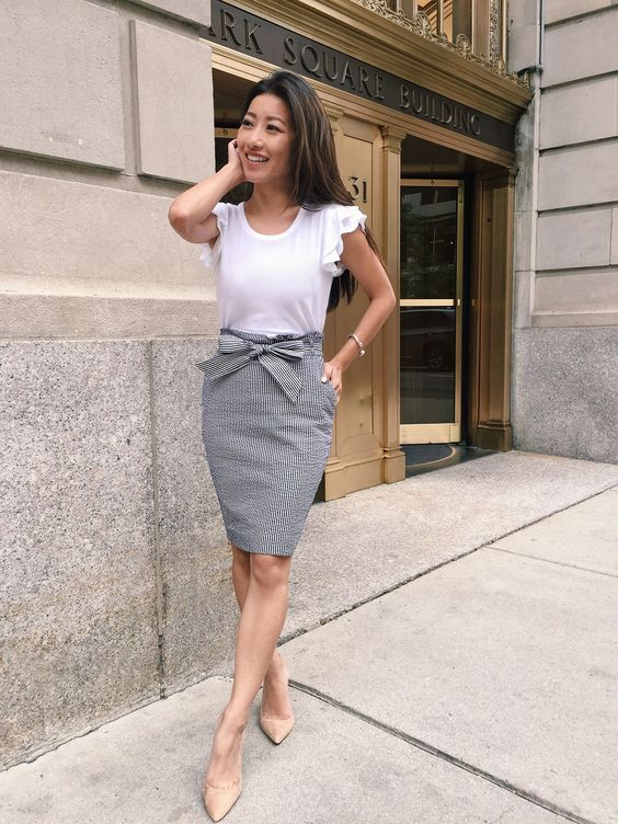 a grey pencil skirt, a white ruffled sleeve top and anude shoes for a summer work look