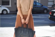 08 a nude top, a rust pleated midi skirt, sandals and a black bag